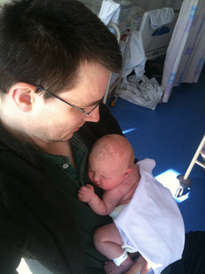 Dad and newborn Saskia