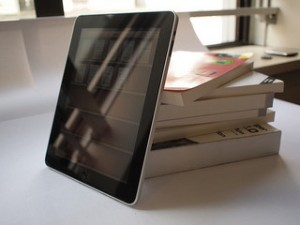 Tablet and Print Books side by side. Image by remiforall @ flickr