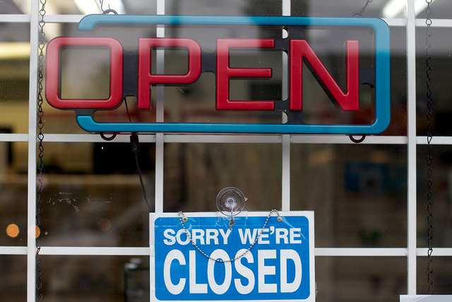 """Open  sign with """"Sorry We're Closed"""" sign beneath it"""