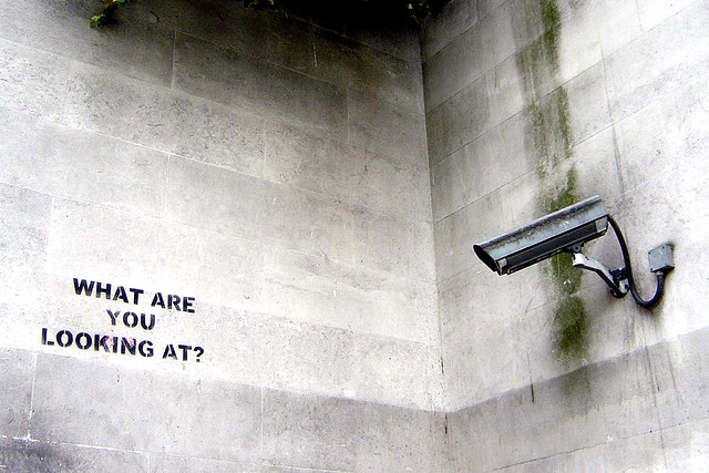 banksy stencil with security camera
